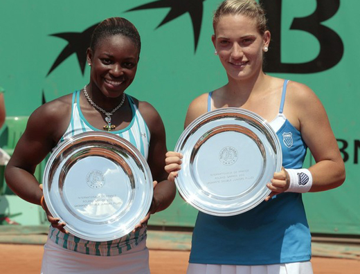 US Sloane Stephens (L) and Hungary's Timea Babos pose after they won the girls' double final match against Spain's Lara Arruabarrena-Vecino and Maria-Teresa Torro-Flor pose in the French Open tennis championship at the Roland Garros stadium, on June 5, 2010 in Paris. Babos and Stephens won 6-2, 6-3. AFP PHOTO JACQUES DEMARTHON (Photo credit should read JACQUES DEMARTHON/AFP/Getty Images)
